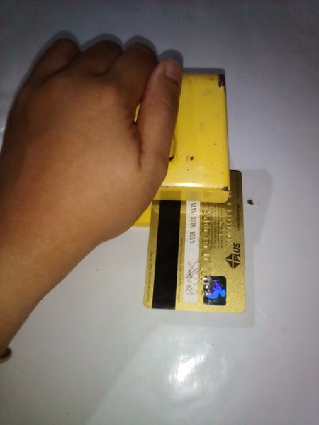 Expired Credit Cards for Storing Earphones - punch holes in the card