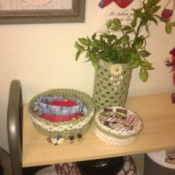 Crochet Accents for a Bathroom with New Colors - jewelry bowls and foliage in cylinder