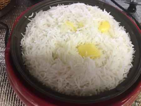 adding butter to rice