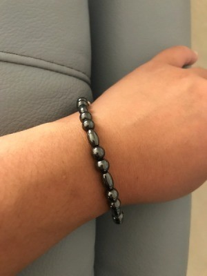 A unisex magnetic bracelet on a wrist.