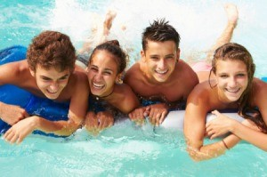 4 teens at a co-ed pool party.