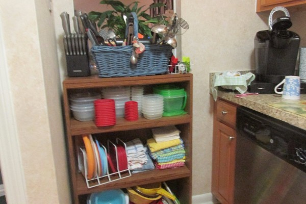 A shelf for organizing a kitchen.