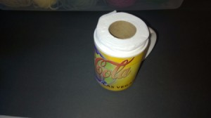 A partially used roll of toilet paper inside a mug for shipping.