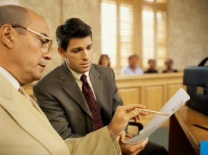 Two lawyers looking at a legal document.