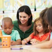 A childcare professional teaching children.