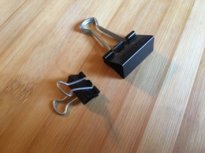 Two different sized binder clips, to be used in the freezer.