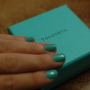 Nails painted in Tiffany blue on a Tiffany jewelry box.