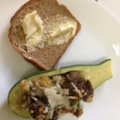 Stuffed Zucchini Squash on plate with buttered bread