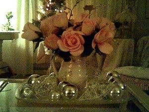 Christmas centerpiece ideas thriftyfun i already had an old pitcher filled with pink silk roses to make it more festive i simply tucked in some gold colored trim from ac moore about a buck a mightylinksfo