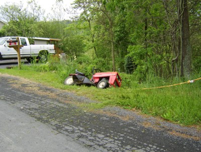Garden: Lawnmower In Ditch