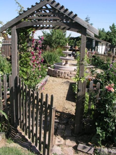 gate open to garden and fountain