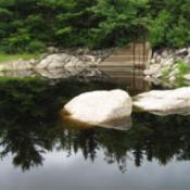 Boulders in water.