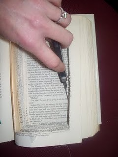 photo of cutting through book pages