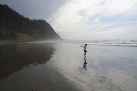 boy on the beach at Manzanita, OR