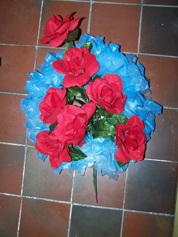 Photo of a Blue Plastic Bag Wreath with Red Flowers