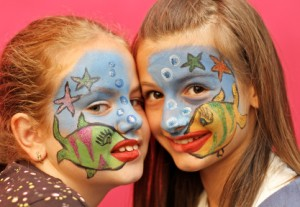 picture of two kids with face paint