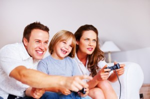 Parents and Child Playing a Video Game