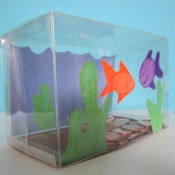 fish tank bank with orange and purple fish cutouts on front