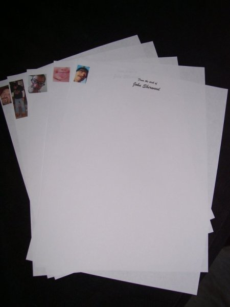 Sheets of personalized stationery that have been computer printed.