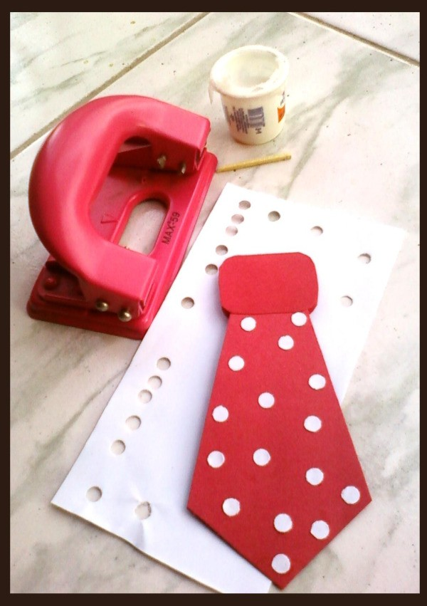 Hole punch, glue and tie with polka dots