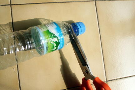 Cut water bottle top off plastic bottle.