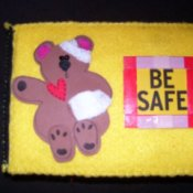 "A felt covered box with a ""boo boo bear"" on the cover."