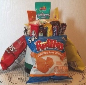 A snack bucket with chips on the outside.