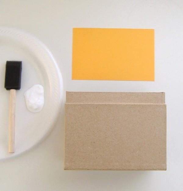 Glue to adhere paper to box.