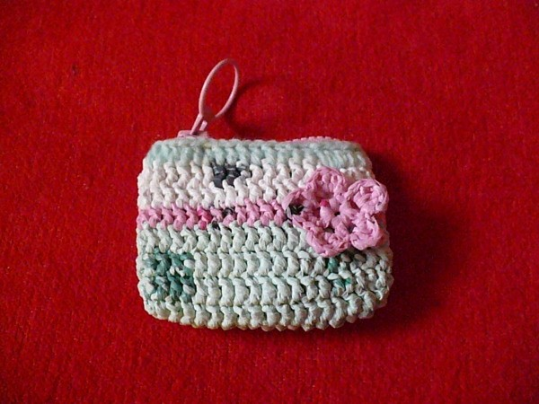 Pink and white plarn coin purse with flower