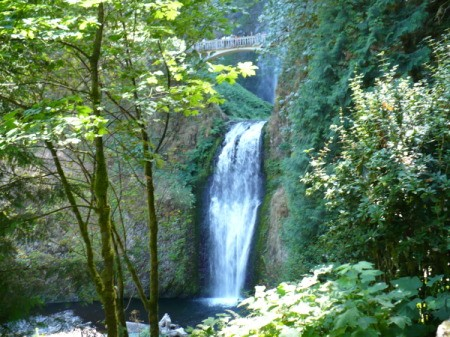Multnomah Falls in Oregon, the lower falls with the bridge in the distance.