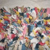 A latch hook rug made from recycled fabrics.