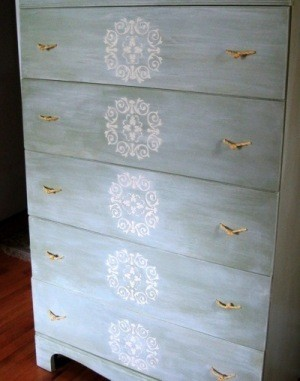 An old dresser fixed up with rope drawer handles.