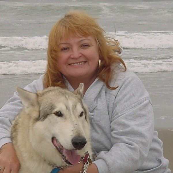 A woman and a dog on the beach in Oregon.