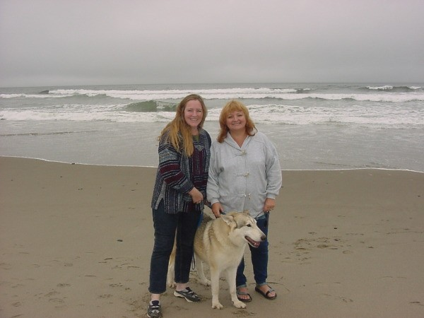 Two women and a dog on the beach in Oregon.