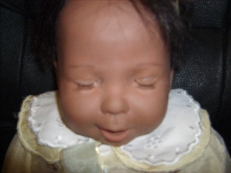 Closeup of doll's eyes closed
