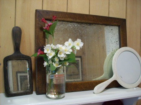 Vintage mirrors on shelf