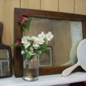 Vintage mirrors on shelf