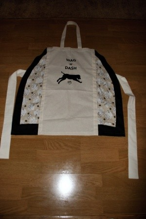 Finished apron made out of a canvas bag.