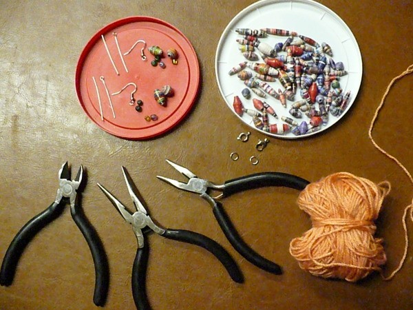 pliers and earring assembly laid out on a table