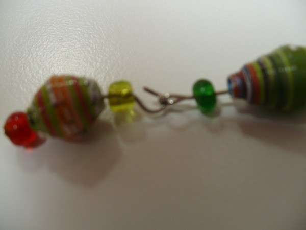 closeup attaching larger bead to hook on bead 1 with hook open