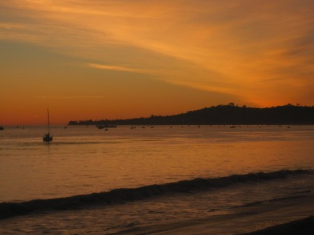 An orange sky at Butterfly Beach near Santa Barbara, California.
