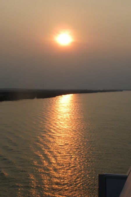 Sunset shining on the rippling waters of the Mississippi River near New Orleans.