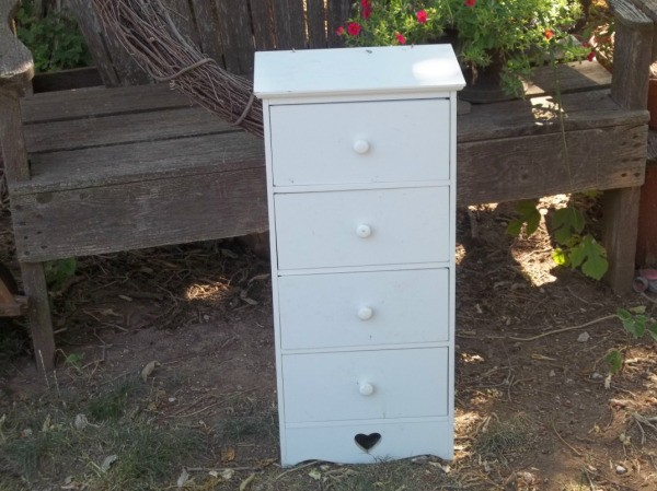 four drawer narrow white chest of drawers with a heart cut out at bottom