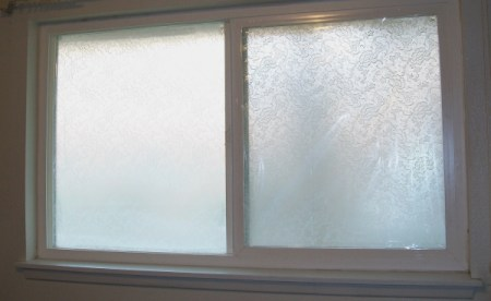 A frosted window with no curtains or blinds.