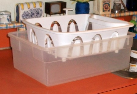 Dish strainer in platic storage tub base