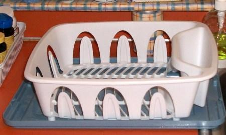 Dish strainer on platic storage tub lid