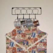 apron hanging on mug rack