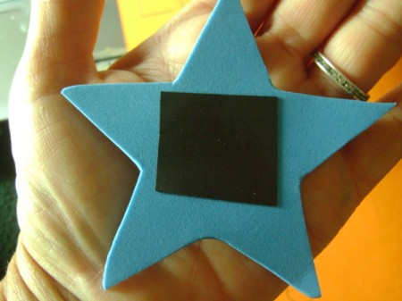Back of foam magnet showing adhesive magnet strip