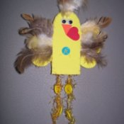 yellow chick magnet with feathers