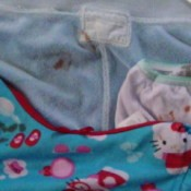 Hello Kitty clothing with lipstick stains.